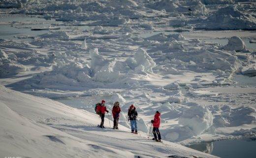 Snowshoers on the edge of the Ilulissat ice fjord in Greenland